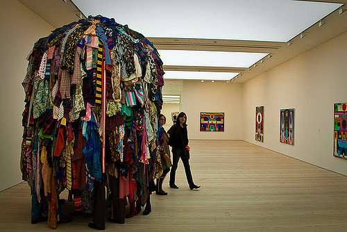 Massive pile of clothes. There must be a chair hidden somewhere. Photo Credit: Martin Yarsavsky (Flickr)
