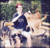 Astrid volunteering at an animal shelter